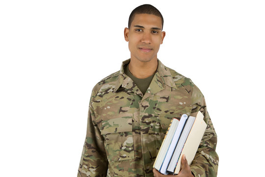 Young soldier holding school books, getting ready to go to college using his GI Bill benefits.