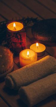 Candle. Dark background.