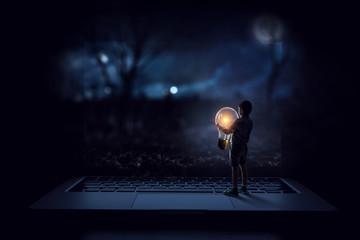 Wall Mural - Boy holding a light bulb