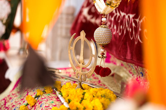 Khanda Symbol of Sikh Faith. Sikhism Faith Gurudwara Decorated by flowers
