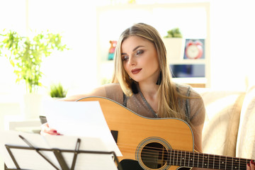 Home Guitar Playing Lesson Girl Hold Instrument. Beautiful Woman at Musical Training. Blonde with...