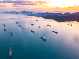 Aerial view from drone, Oil tanker ships off the coast in beautiful light sundown, professional business logistics and transportation of energy fuels.