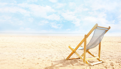 Deck chair on beach send empty copy space background,summer esort view,tourism banner.