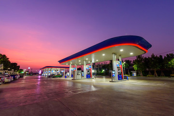 Samutsakhon, Thailand -  3  March,2020 :  PTT petrol station with a lot of car  in sunset time