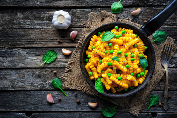 Vegan Mac and Cheese with green peas. Clean eating, plant based food concept
