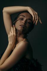 Foto op Canvas Zwaan fashion portrait of beauty elegant girl posing in black veil on dark background. gorgeous stylish model woman in black dress with feathers. Art creative concept of black swan or dark angel