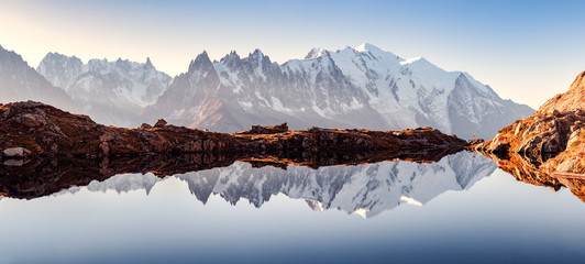 Fototapeta Incredible view of clear water and sky reflection on Chesery lake (Lac De Cheserys) in France Alps. Monte Bianco mountains range on background. Landscape photography, Chamonix. obraz