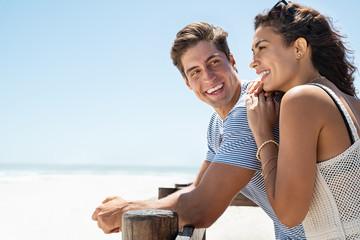 Fototapeta Smiling couple enjoying day at beach obraz