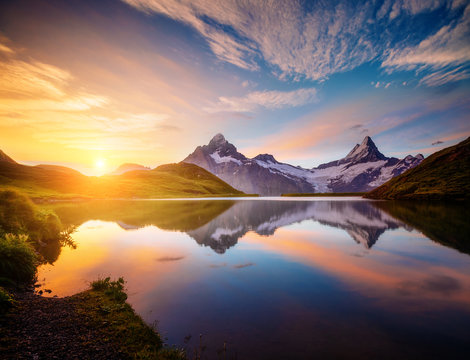 Magnificent panorama of the alpine lake Bachalpsee at dawn. Location Swiss alps, resort Grindelwald,