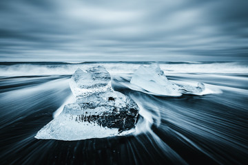 Keuken foto achterwand Antarctica Incredible pieces of the iceberg sparkle on black sand. Location Jokulsarlon lagoon, Diamond beach, Iceland, Europe.
