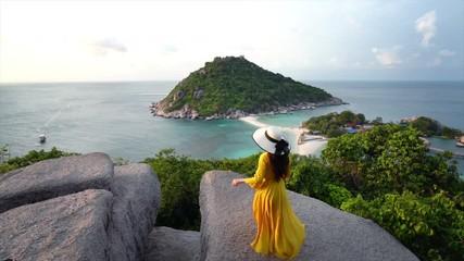 Wall Mural - Tourist walking on the rocks at Koh Nangyuan viewpoint, Thailand.