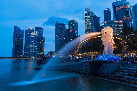 Night view of Singapore Merlion at Marina Bay against Singapore