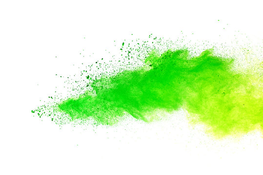 Green and yellow powder explosion on white background.