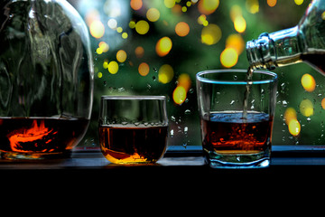 Cheers clinking of friends in party. Whisky In A Glass. Light Bokeh Background.