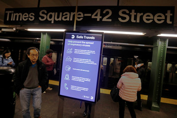 Signage advising on how to prevent the spread of respiratory viruses is seen on the subway platform at the Times Square station after further cases of coronavirus were confirmed in New York City