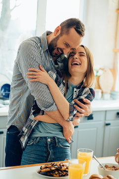 Adorable couple laughing and hugging stock photo