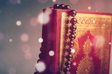 Islamic Book Koran with rosary on desk