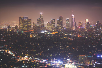 Wall Murals Los Angeles Beautiful super wide-angle night aerial view of Los Angeles, California, USA, with downtown district, mountains and scenery beyond the city, seen from the observation deck of Griffith Park observatory