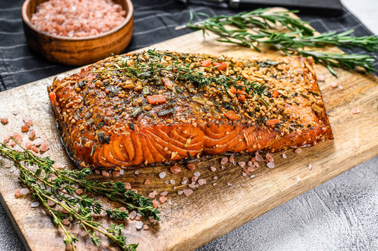 Hot smoked salmon fillet on a cutting Board. trout. Gray background, top view.