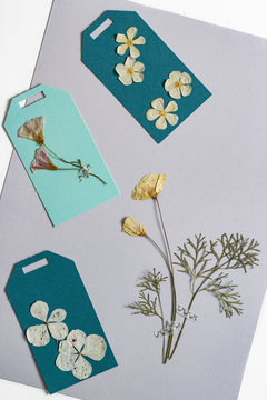 Teal and mint gift tags with dried flowers