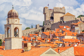 Zelfklevend Fotobehang Mediterraans Europa Summer mediterranean cityscape - view of the roofs of the Old Town of Dubrovnik on the background on of the city walls and of the Minceta Tower, Adriatic coast of Croatia