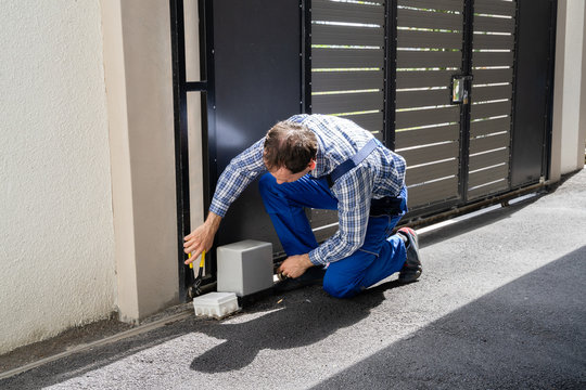 Repairman Fixing Broken Automatic Door