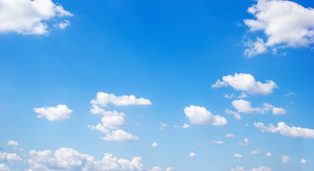 Blue sky background and white clouds soft focus, and copy space Wall mural