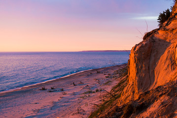 Stunning sunset clouds above the Baltic sea coast, Latvia. Cliffs close-up. Golden evening sunlight. Summer landscape Fototapete