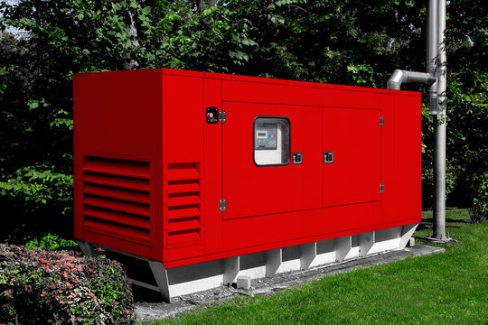 red diesel emergency generator for uninterruptible power supply, fuel installation in an iron casing with an electric switchboard power control.