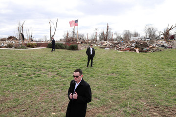 U.S. President Donald Trump surveys tornado damage during a visit to Cookeville, Tennesee