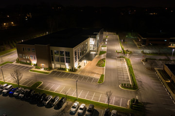 Aerial photo office building and parking lot at night Wall mural