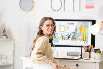 Female interior designer working in office Wall mural