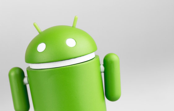Google Android figure closeup on grey background. Google Android is the operating system for smartphones, tablet computers, e-books and other devices. Moscow, Russia - March 19, 2019