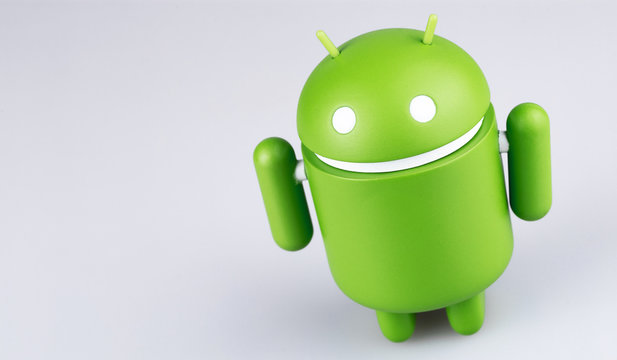 Google Android figure on grey background. Google Android is the operating system for smartphones, tablet computers, e-books, game consoles, and other devices. Moscow, Russia - March 19, 2019