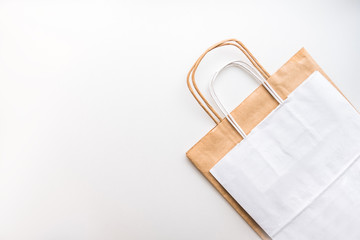 Сraft and white eco-friendly paper bags isolated on white background with copy space