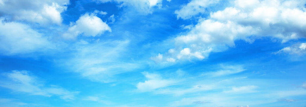 Sunny background, blue sky with white cumulus clouds