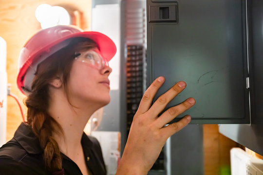 close up on construction inspector woman inspect house electrical systems, inspecting a modern eco energy efficient home. check the Distribution board