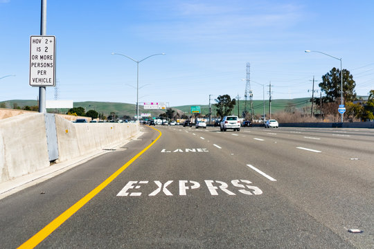 Express Lane marking on the freeway; San Francisco Bay Area, California; Express lanes help manage lane capacity by allowing single occupancy vehicles to use them for a fee
