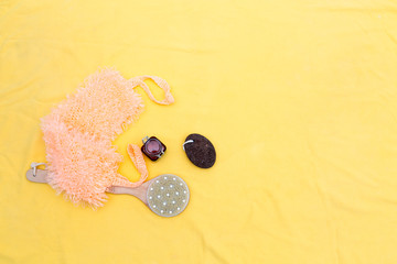 Photo sur Plexiglas Zen pierres a sable sauna kit: washcloth, pumice stone , brush, candle on yellow background
