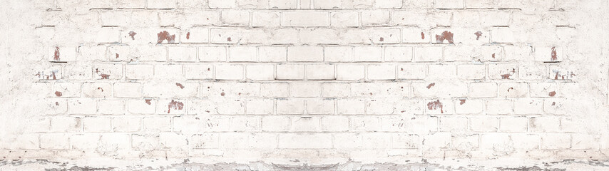 White painted damaged rustic brick wall texture banner panorama
