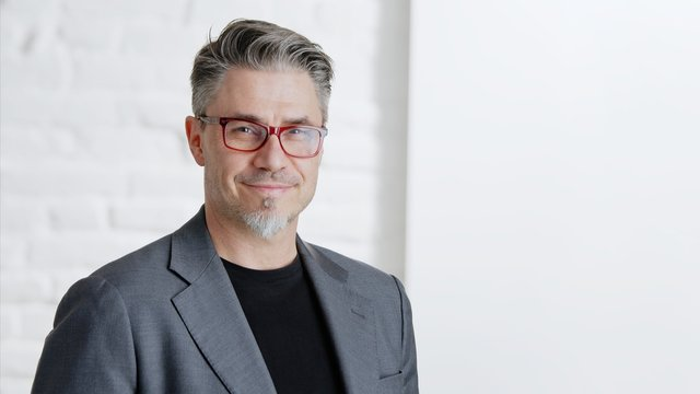 Happy good looking older businessman in glasses