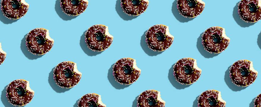 Chocolate glazed donuts overhead view flat lay