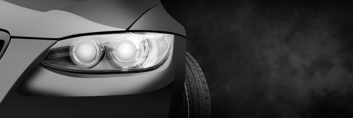Car headlight on a black dark background