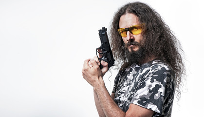 Portrait of the skinny, funny man holding a gun