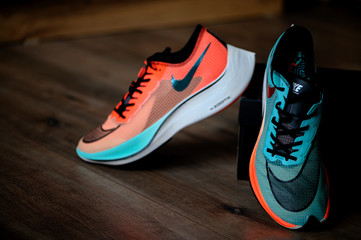 BANGKOK, THAILAND, MARCH 7. 2020: Nike running shoes Vaporfly NEXT%. Controversial Athletics marathon shoe, Ekiden Color version, Detail view on Zoom foam and Nike Flyknit uppers,