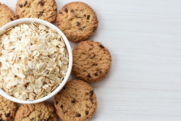 Deurstickers Koekjes Oatmeal cookies and chocolate chips on light background