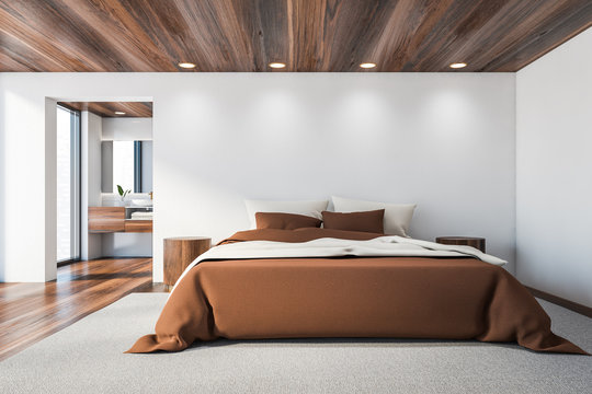 White master bedroom and bathroom, brown bed