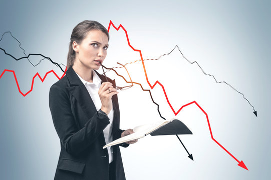 Thoughtful young businesswoman, falling graph