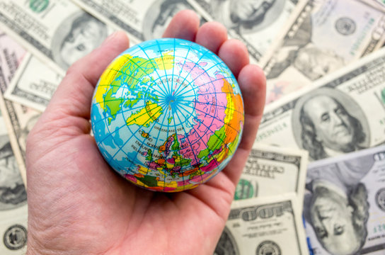 Globe on a pile of dollars planet earth