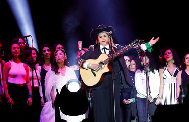 """Songwriter Vivir Quintana performs with members of the female collective of Latin-American singers and authors 'El Palomar', as they sing """"Song Without Fear."""", a song against femicide, at Zocalo square in Mexico City"""